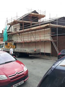 commercial property with scaffolding around the exterior
