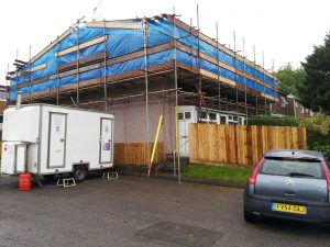 house with scaffolding around roof