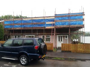 bungalow with scaffolding around roof