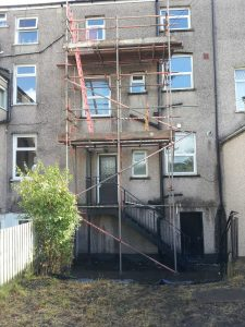 scaffolding outside block of granite flats