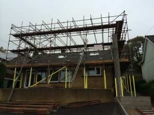 bungalow with scaffolding on exterior