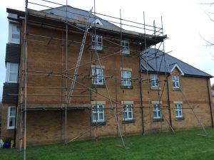 scaffolding outside block of brick flats