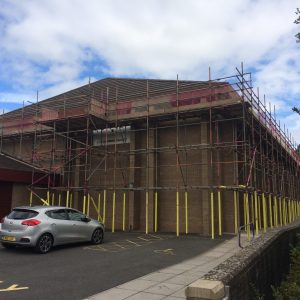 leisure centre with scaffolding around the outside